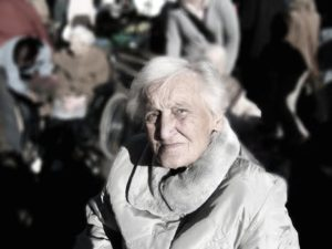 Older woman looks into camera in dismay to show the difficulties in taking care of elderly people who do not want to be taken care of