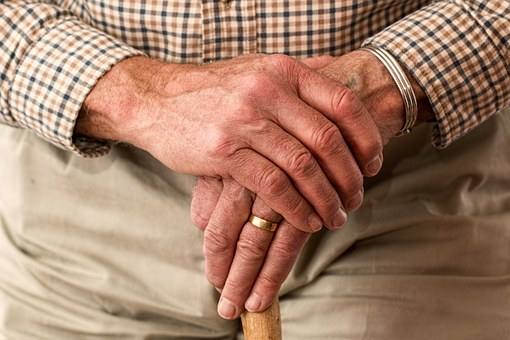 hands elderly man helping elderly relatives around the house