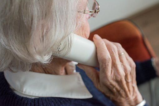 woman phoning helping elderly relatives around the house